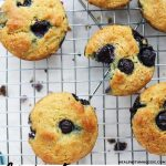 Lemon blueberry muffins on a baking sheet.