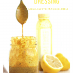 a spoon dripping with dressing and a lemon next to it.