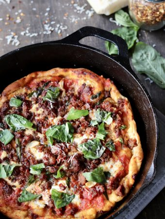 Make this fennel chicken sausage pizza for your next night in! The cast iron skillet gives the perfect browning to the crust and makes for an easy clean up! | Mealswithmaggie.com