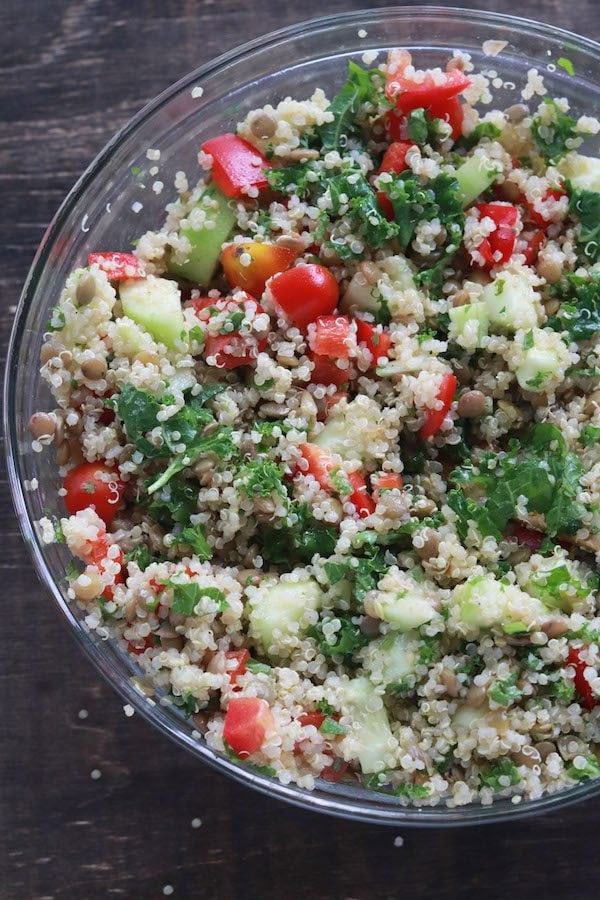 This quinoa lentil salad is a summery blend of fresh vegetables, lentils and cilantro. It is vegan, vegetarian and gluten free! Great for meal prep. #vegan #Vegetarian #glutenfree #coldsalad #mealpreplunches #easymealprep | Mealswithmaggie.com