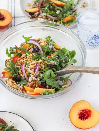 This antioxidant summer salad is filled with sweet peaches, tangy blue cheese, tart dried cherries and nutty walnuts combined with the bite of the red onion makes this salad a joy to eat. Serve this up at your next dinner party | Mealswithmaggie.com #peaches #peachsalad #summerpeachsalad #antioxidants #healthysummerdish #peachrecipes #driedcherries