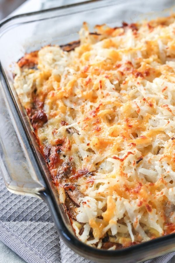 This protein packed breakfast casserole is filled with savory sausage, vegetables and crispy hashbrowns. Perfect for prepping the night before for a tailgate or brunch with friends. | mealswithmaggie.com #proteinpacked #breakfastcasserole #healthybreakfastcasserole #fennel #sausage #hashbrowns #eggcasserole