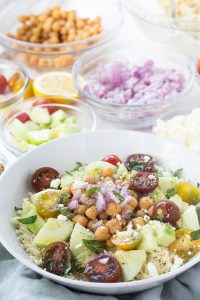 This Greek Orzo Salad is full of fresh, bright ingredients with Middle Eastern spices. A great vegetarian option for meal prep or potluck. | Mealswithmaggie.com #greekorzosalad #mealpreplunch #vegetarian #easygreeksalad #easypastasalad #pastasalad #greekpastasalad