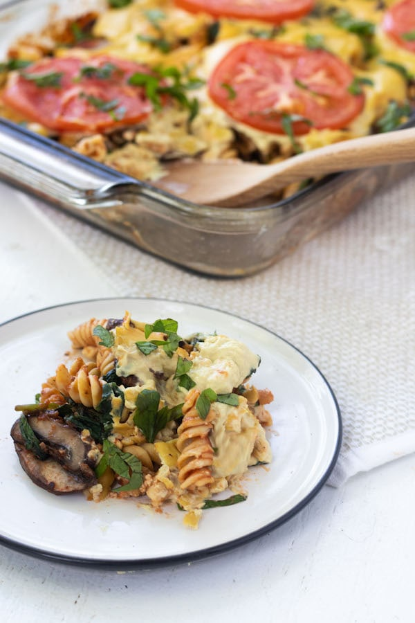 High Protein Vegan Pasta Bake- Made of tofu, nutritional yeast, hummus and chickpea noodles. This pasta bake is FULL of creamy plant based power! 20 grams of protein a serving. | mealswithmaggie.com  #vegan #vegancasserole #dairyfree #glutenfree #highproteinvegan #highproteinveganpasta #pasta #casserole #pastabake