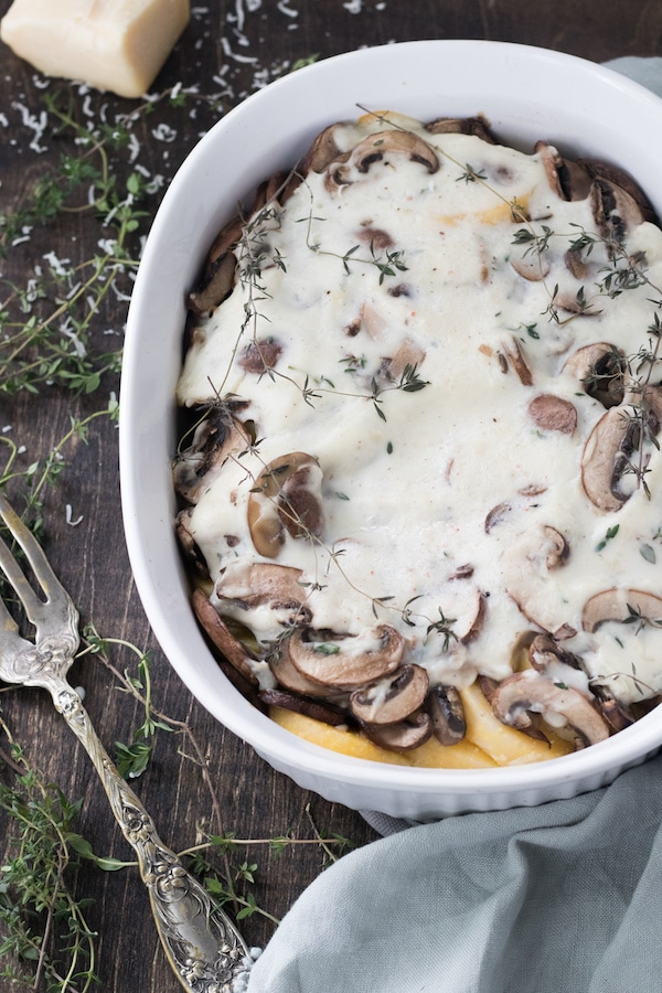 Baked polenta and mushroom casserole – This casserole is a tasty holiday side dish that is gluten free and option to be vegan. The combination of polenta, mushrooms and thyme creates a harmonious blend of flavors that lends a new definition to comfort food. | MealswithMaggie.com #healthythanksgiving #casserole #thanksgivingcasserole #glutenfreecasserole #veganthanksgiving #healthycasserole