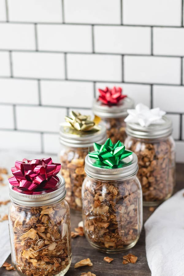 mason jars filled with healthy holiday granola on counter