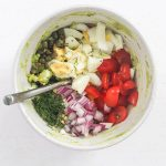 All of the healthy avocado egg salad ingredients in a bowl separately