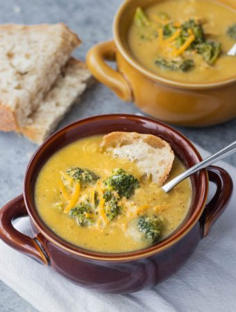 Chicken Broccoli cheddar soup in a bowl with bread