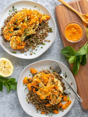 Cauliflower on a plate with lentils, capers and mint.