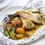 a foil packet with chicken and vegetables in it.