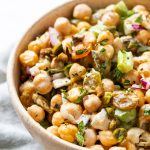 Side view of salad in bowl with mint and chickpeas