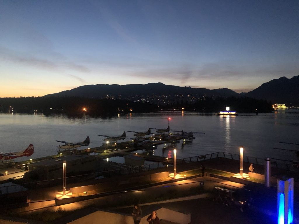 seaplanes docked at night in Vancouver.