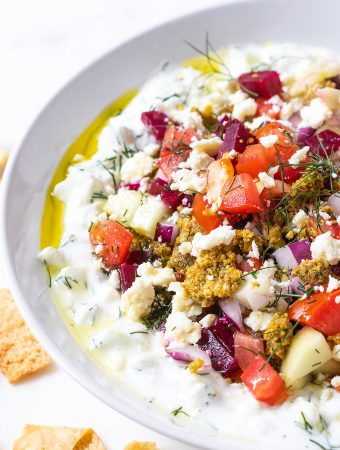 Cucumber dip with toppings with drizzle of olive oil