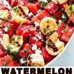 watermelon in a bowl with feta and mint on top.