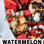 watermelon with shrimp and feta in a bowl with mint.
