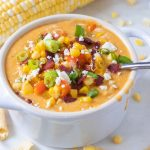 Chicken corn chowder in a bowl with a spoon.