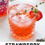 Vodka drink with strawberries and thyme