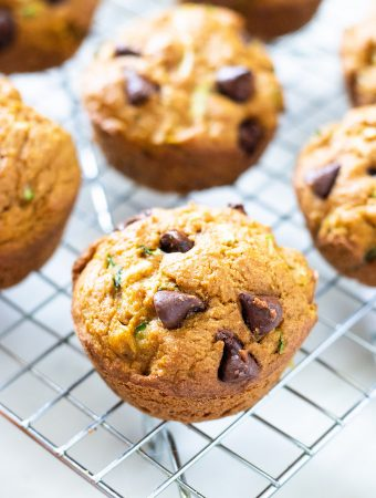 zucchini pumpkin muffins on a cooling rack.