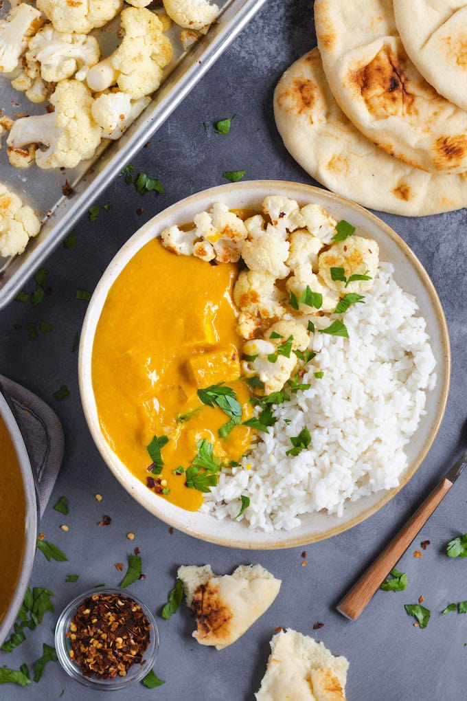 A view of a butternut squash curry with cauliflower and rice.