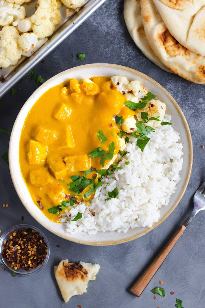 A bowl of butternut squash curry with tofu.