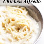 Chicken Alfredo in a pan with sauce.