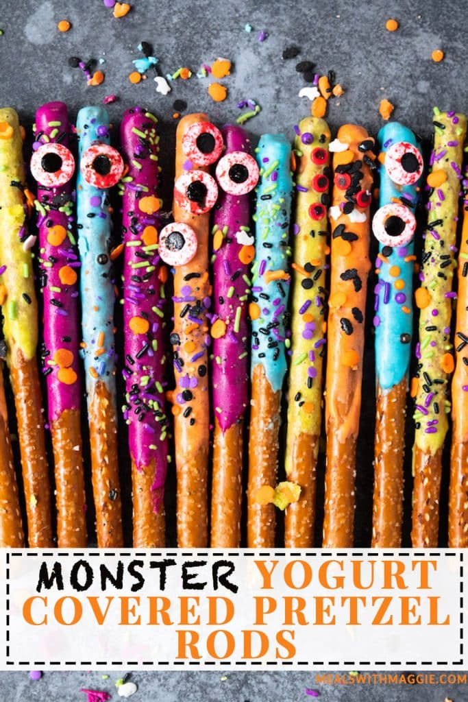 Yogurt covered pretzel rods with sprinkles and eyeballs.