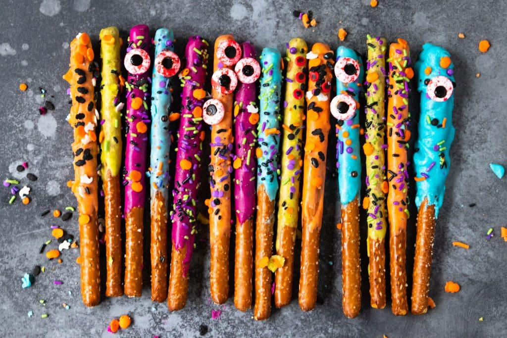 A row of pretzels covered with sprinkles