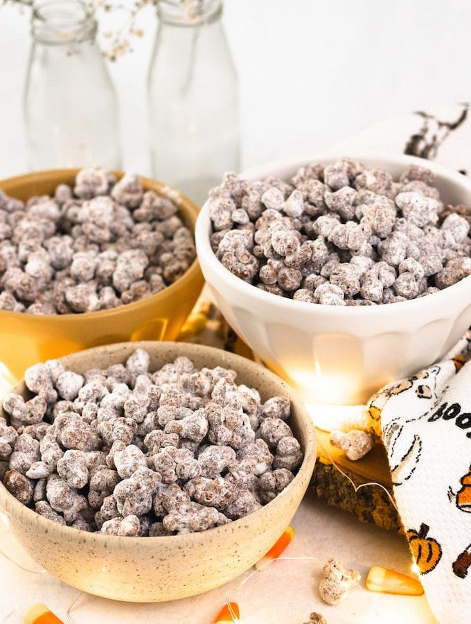 Puppy chow in bowls with candy corn
