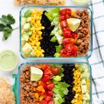 Taco salad in meal prep containers.