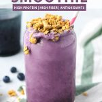 a blueberry smoothie with granola on top and text above it.