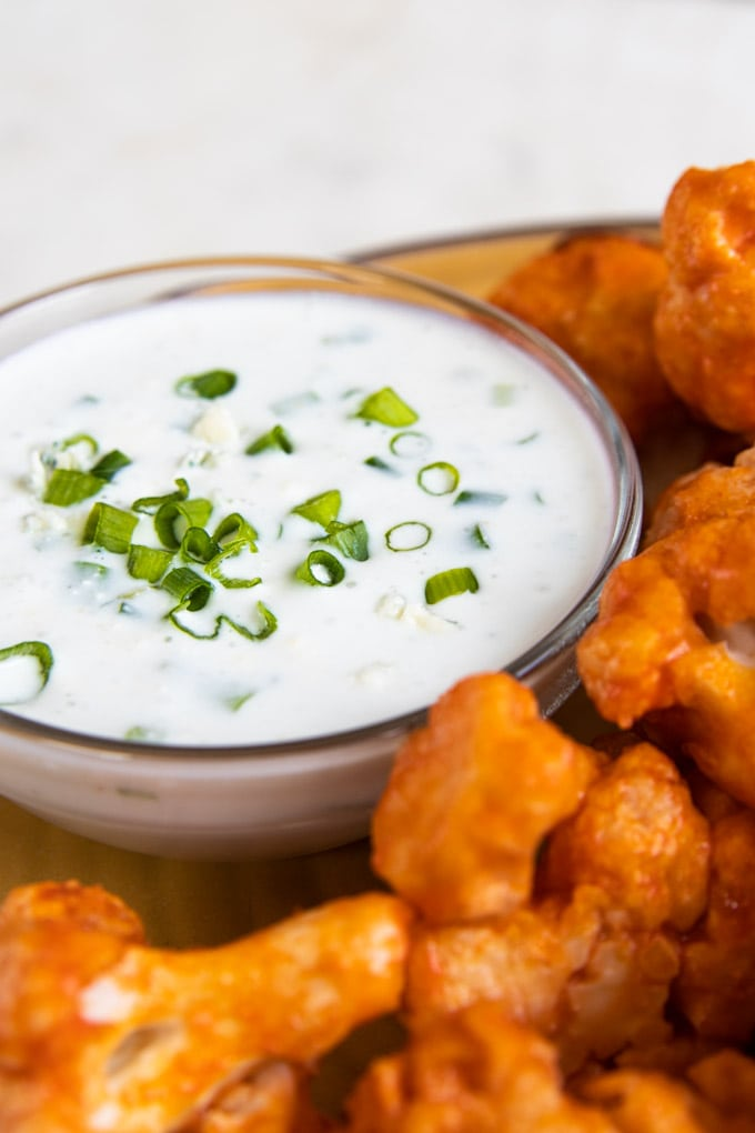 blue cheese dip with green onions on top.