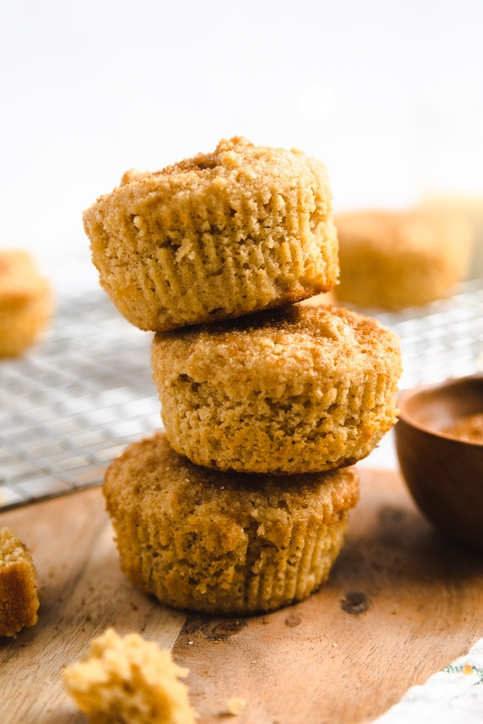 three muffins on top of one another with cinnamon sugar on top.