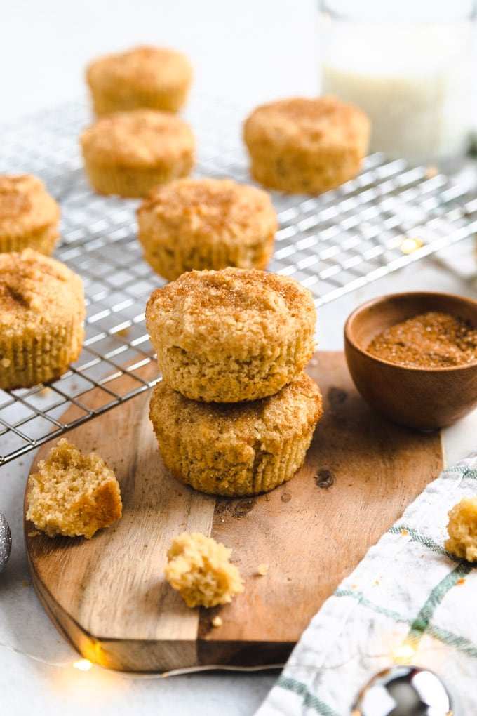 Snickerdoodle muffins with crumbs around them.