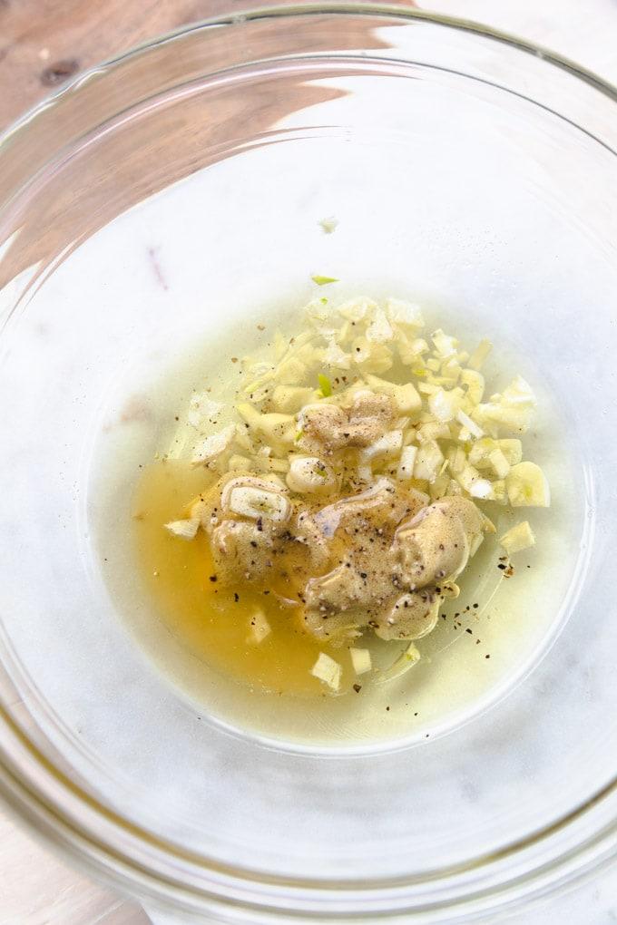 Ingredients for honey mustard chicken in a bowl.