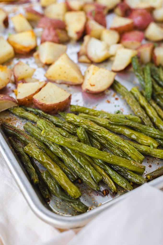 A close up of roasted green beans.