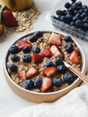 Bowl of instant pot oatmeal with berries on top and a spoon.