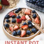 text under a bowl of old fashioned oatmeal with berries.