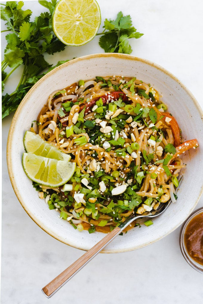 a bowl of pad thai with peanut sauce.