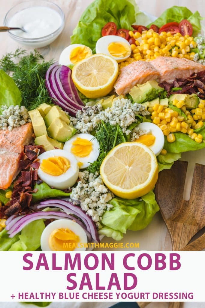 salmon Cobb salad text under colorful salad