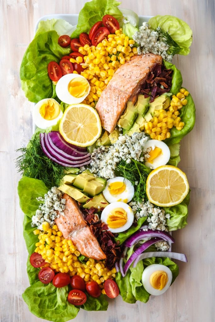 salmon salad on a plate with toppings.