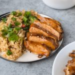 Chicken teriyaki on a plate with rice.