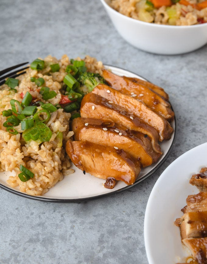 Teriyaki on a place with rice.