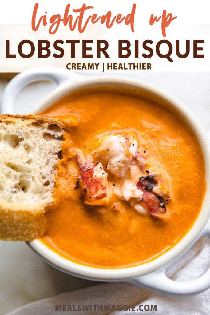 a bowl of lightened up lobster bisque soup with bread and text above it.