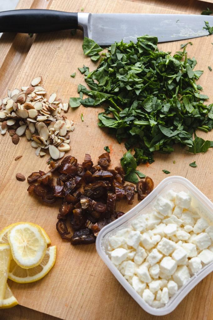 Ingredients for cauliflower salad on a cutting board.
