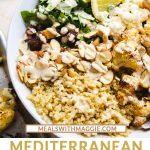 A bowl of Mediterranean salad with quinoa and lemon tahini dressing.