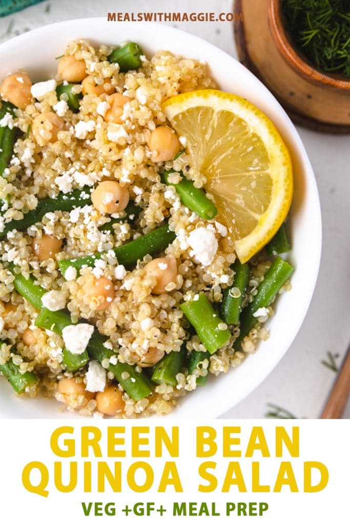 A bowl of green bean quinoa salad with a lemon wedge in it.