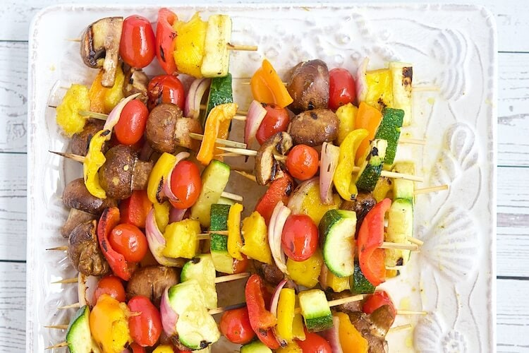 vegetable kabobs on a plate.