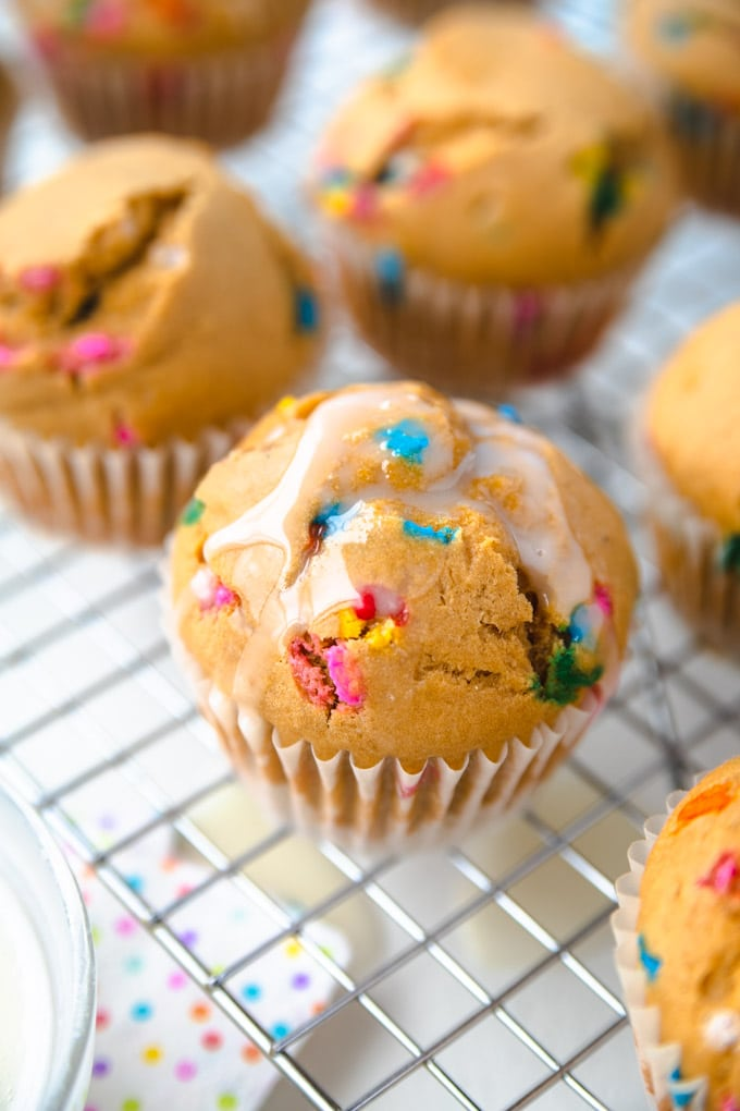 a bunch of healthy funfetti cupcakes on a rack.