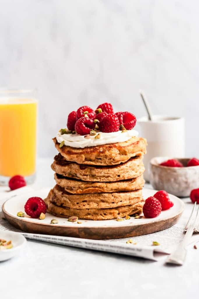 pancakes stacked on top of each other with raspberries.
