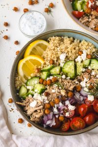 Chicken shawarma in a bowl with toppings.